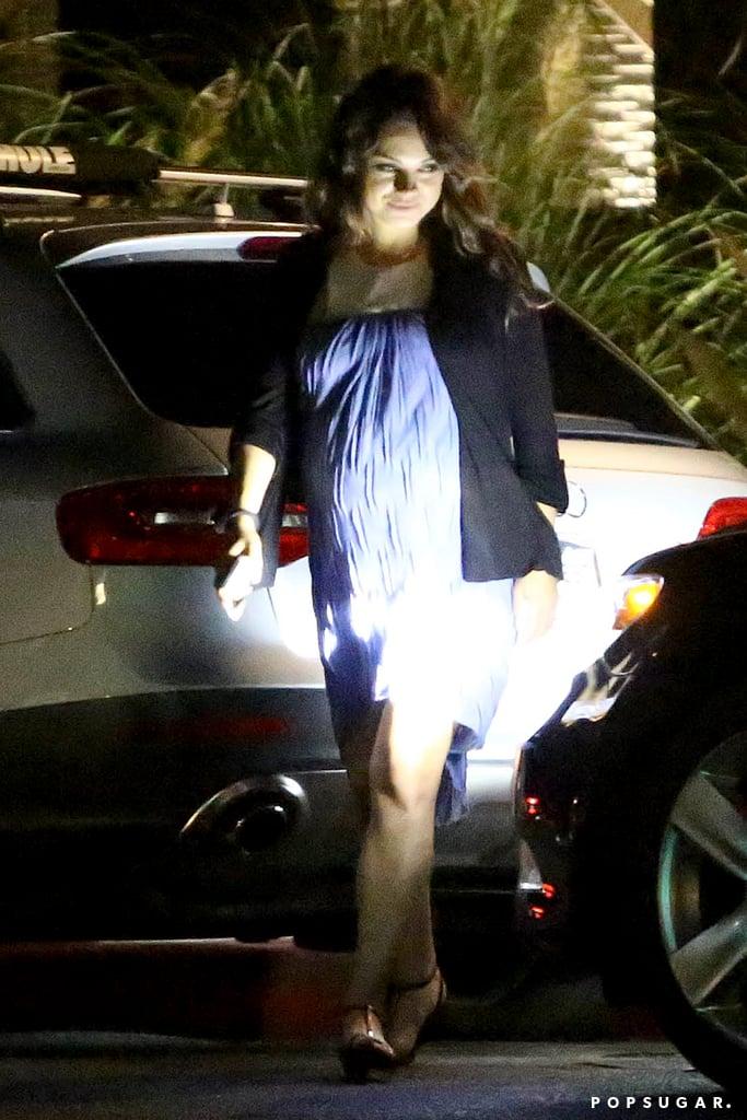 Aww! Mila Kunis Holds Her Growing Baby Bump