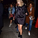 Taylor styled her triple-buckle Prada boots with an oversize bomber, a beaded minidress, and a bejeweled crossbody bag.