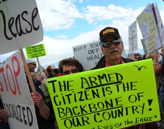 Front Page: People Keep Bringing Guns to Healthcare Protests