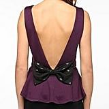 This Pins and Needles bow back peplum top ($39) is cute from the front but even cuter from the back.