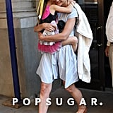 Katie Holmes carried Suri Cruise who held on tight in NYC.