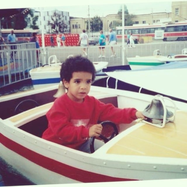 Baby Drake driving a t...