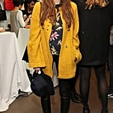 Elizabeth Olsen brightened her all-black bottoms with a floral blouse and nubby yellow coat while perusing the Cher Coulter capsule collection for AG Jeans.