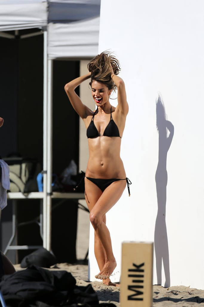 "Alessandra Ambrosio suited up in a tiny black bikini yesterday to shoot a Victoria's Secret campaign in Malibu. She's been on a week-long shoot with VS, which has included modelling a rainbow two-piece and meeting up with her fellow Angel Adriana Lima for the cameras. Alessandra will have plenty of time to catch up with her VS model buddies today when she hosts a meet and greet at the lingerie brand's store in Beverly Hills with Karlie Kloss and Candice Swanepoel. She posted news about the Victoria's Secret meet-up on her Facebook page, asking fans to take photos with the three beauties. Alessandra wrote, ""Hope to see you there for lots of fun and a swimsuit giveaway!"""