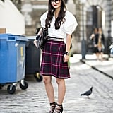 Update schoolgirl plaid with stud add-ons and a pair of sexy lace-up heels. Source: Adam Katz Sinding