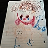 """My son drew a picture of Mommy as I'm sick right now. Complete with germs in my body, watering eyes, and a pile of tissues next to me. But I still sport a smile on my face according to him."""