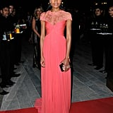 A bold color went a long way with Naomie Harris's coral Monique Lhuillier gown at the Dubai International Film Festival.