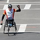 Ernst van Dyk celebrated after winning the men's wheelchair division.