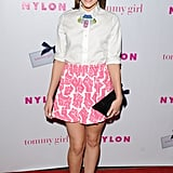 At a Nylon bash in Hollywood in May, Christa showed off her colorful side in a pink printed miniskirt, Kelsey Quan colorful bib necklace ($395), a Kzeniya clutch, and hardcore Vince Camuto ankle-strap sandals ($98, originally $118).