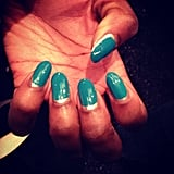 A close-up of the blue two-tone nails by Sally Hansen at Tracy Reese.