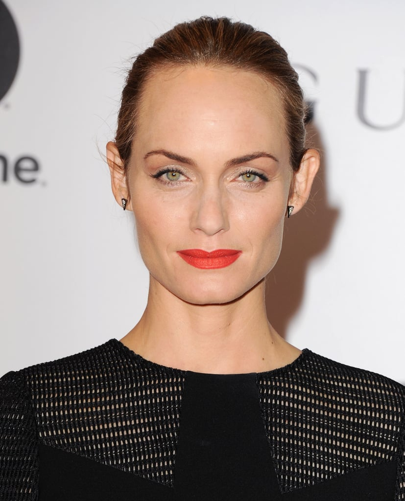 Model Amber Valletta brightened up her face with a matte poppy lip and shimmery silver eye shadow.
