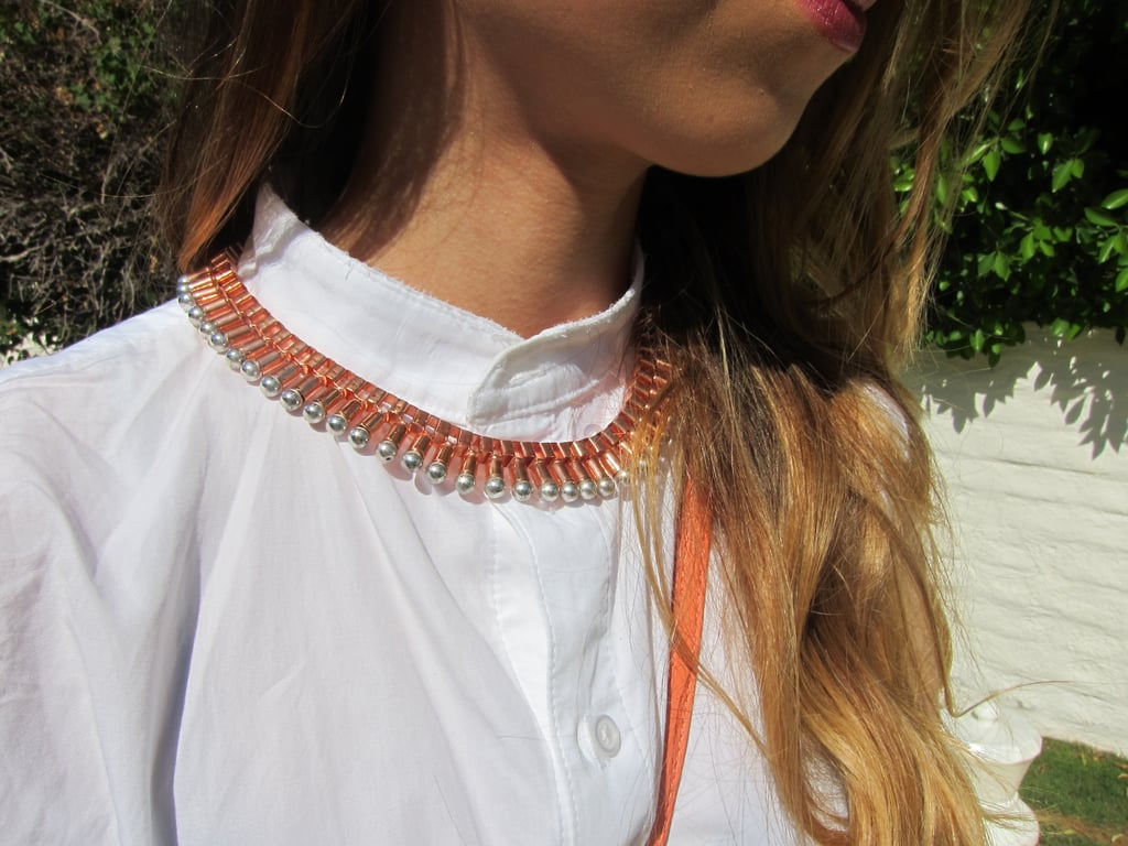 The rose-gold and silver bib necklace is equal parts pretty and tough.