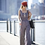 Live Your Parisian Dreams With a Tweed Jumpsuit, Baker Boy Hat, and Quilted Bag