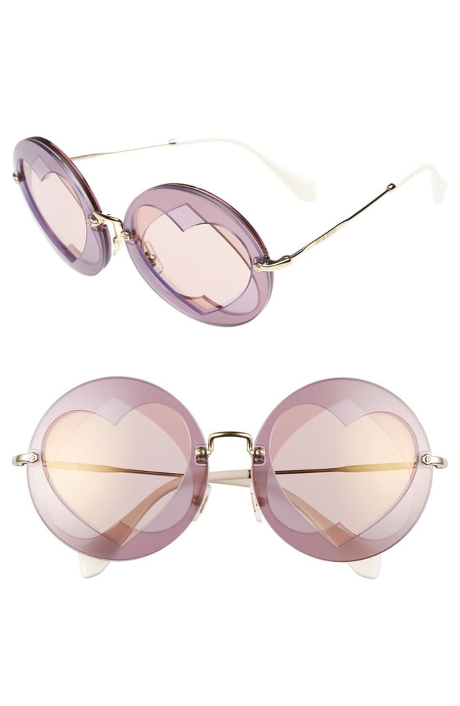 Grab a pair of funky retro sunglasses like these Miu Miu Heart Shades ($410)