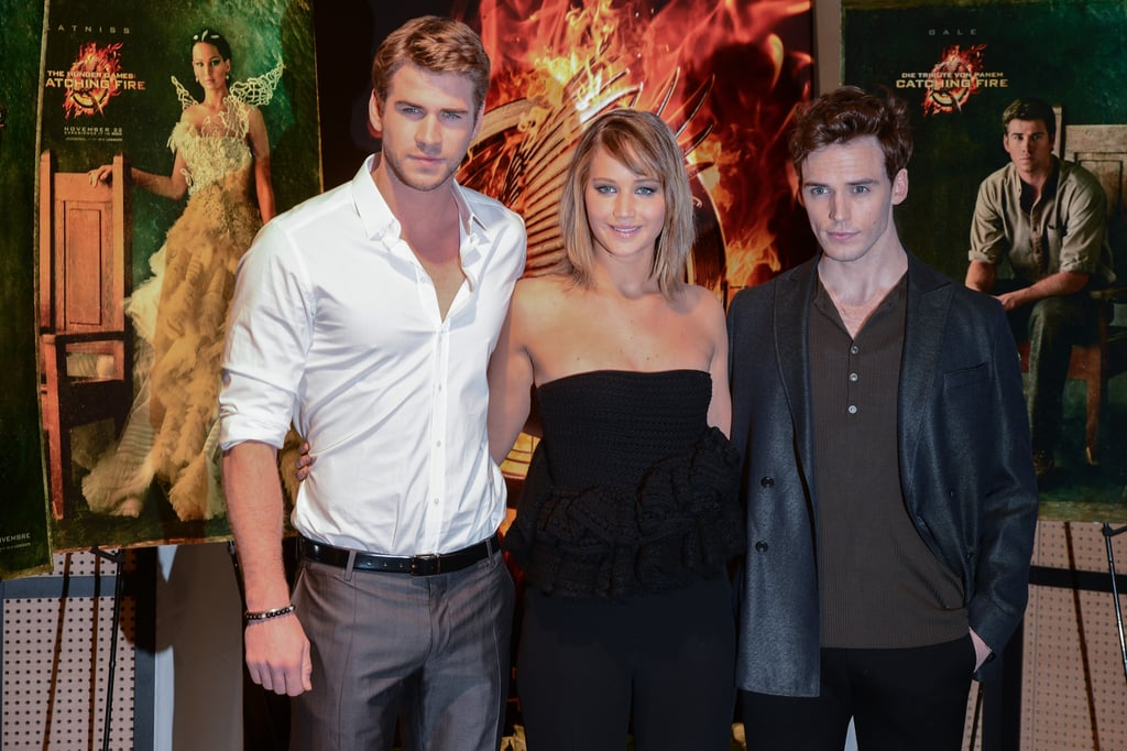 Liam Hemsworth, Jennifer Lawrence and Sam Claflin attended a photo call for Catching Fire.