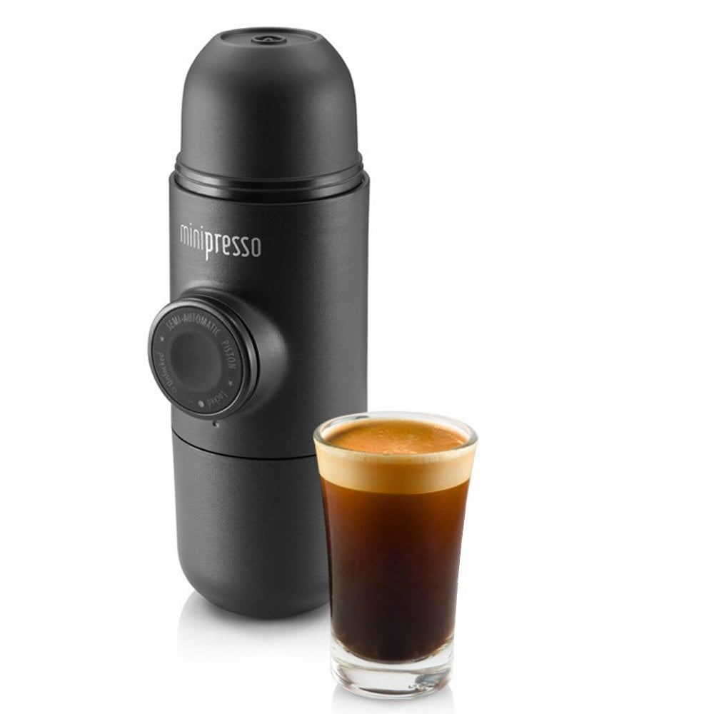 This is a top-seller on Amazon. It's a non-electrical, portable espresso machine, that fits in your hangbag. Wacaco Minipresso Coffee Machine Portable Espresso Maker Travel Set Mug Cup ($77.95)