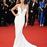 Cindy Crawford turned heads in 2013 in a white, curve-hugging Roberto Cavalli gown.