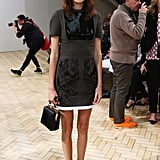 Alexa Chung took her front row seat at J.W. Anderson in a mixed-media LBD.