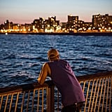 A man looked at the view of NYC from the Coney Island beach.