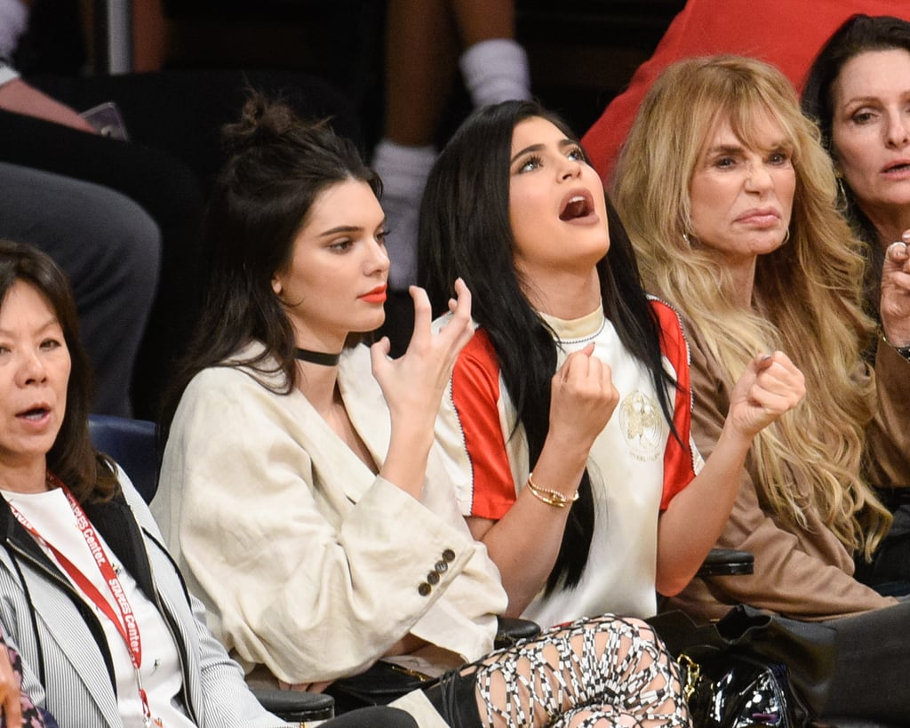 Kendall and Kylie Jenner Share Plenty of Sisterly Moments (and Side-Eye) at the Lakers Game