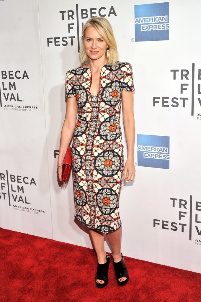 Naomi Watts donned a bold printed Alexander McQueen sheath dress styled with Monique Péan earrings and an orange clutch to the world premiere screening of her film Sunlight Jr.