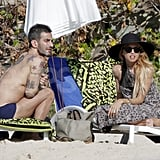 Rachel Zoe protected her face with a floppy hat while chatting with shirtless Marc Jacobs.