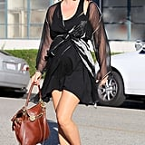 Ali Larter is proof that pregnancy can be oh-so-chic. Digging the sheer jacket and contrasting tan bag.