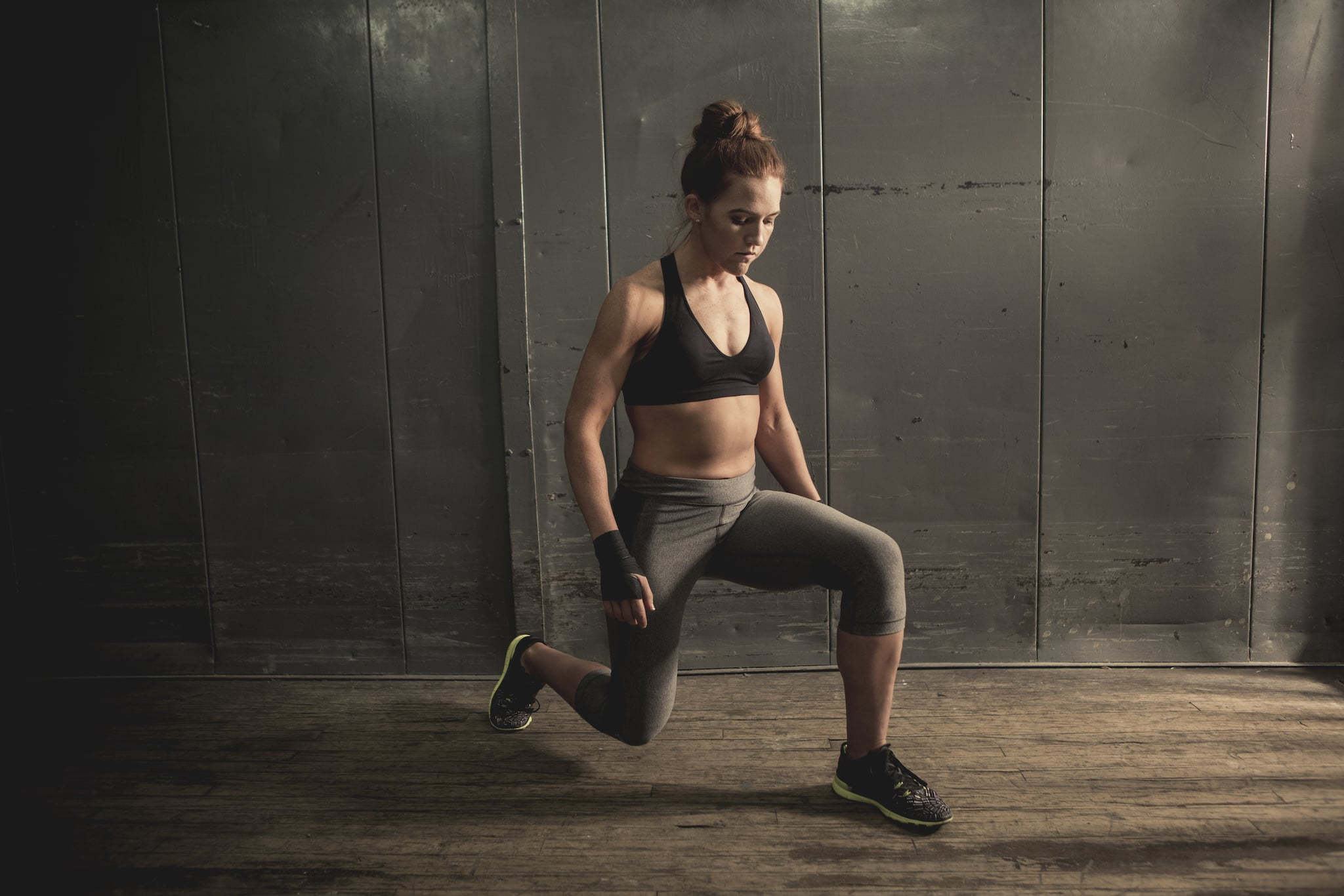 An athletic woman doing lunges (stock image).