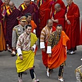 King Jigme Khesar Namgyel Wangchuck walks with the Prime Minister of Bhutan on the way to his wedding ceremony.