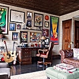 The den is an eclectic mix of magic memorabilia, Gibson guitars, and masculine leather furnishings.