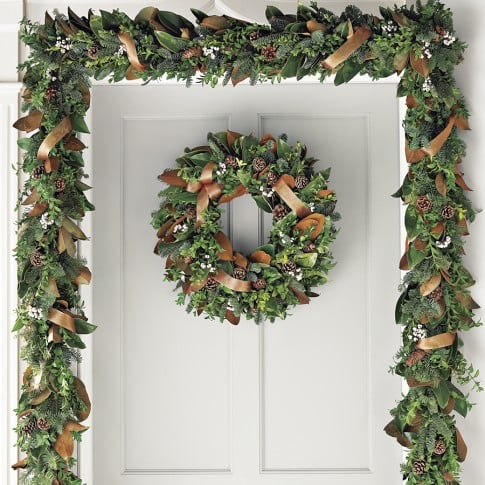 Get the look with Copper Ribbon Garland ($100-$130). Fresh magnolia leaves, sprigs of boxwood, and noble fir give this garland old-world charm.