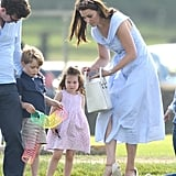 Ah, the sibling roles are back to normal, and George manages to get both his hands on said slinky. The real star of this photo, though, is Kate attempting to get her life together in the fleeting minutes she has before the kids get bored or hungry.
