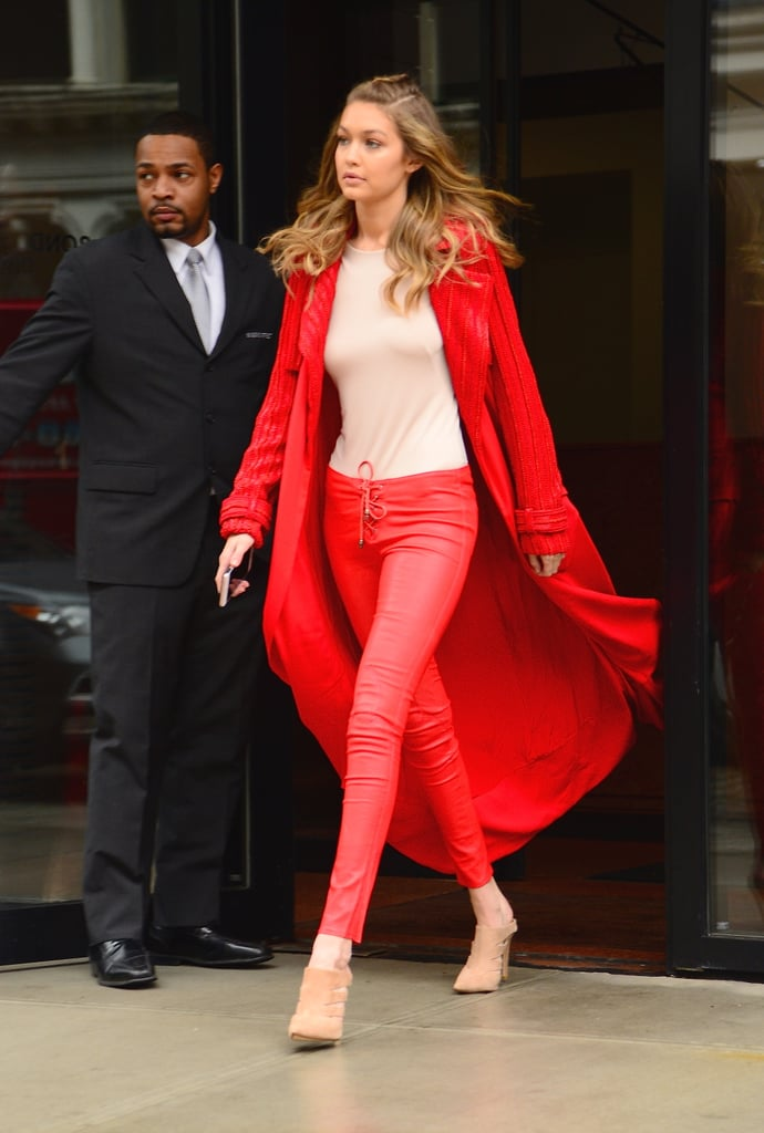Gigi's not afraid to wear red and rocked the look with a long beaded Sally LaPointe cardigan and lace-up Chrome Hearts pants. She wore a neutral-colored Atea Oceanie bodysuit and suede Raye heels.
