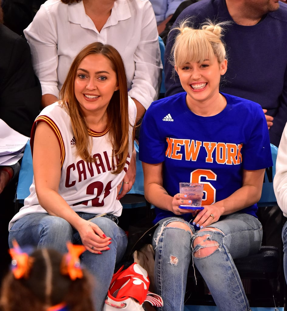 Miley Cyrus and her sister Brandi were quite the adorable pair at Madison Square Garden in NYC on Saturday. The duo, who were accompanied by their mother, Tish, looked as happy as can be while watching the Cleveland Cavaliers take on the New York Knicks. On top of casually showing off her gorgeous engagement ring from Liam Hemsworth, Miley seemed to be having a whole lot of fun, grinning from ear to ear, sharing a few drinks with her sister, and snapping a few fun selfies with New York Giants football star Victor Cruz and Cleveland Cavalier J.R. Smith. While there were no signs of Liam, E! News reported that Miley and Liam had officially resumed their engagement back in January. Keep reading to see more of Miley and Brandi's sisterly date, then check out even more celebrity sisters.