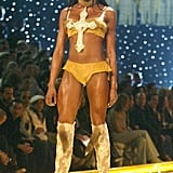 Naomi's cross bra and fur boots made a statement on the runway in 2002.