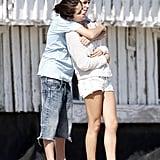 Justin Bieber cuddled with Selena Gomez on the beach in Malibu in September 2011.