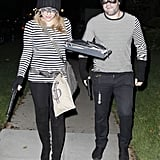 Hilary Duff and Mike Comrie dressed as robbers.