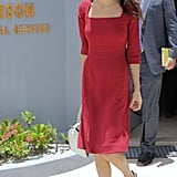 Amal stepped out in a knee-length red Dolce & Gabbana dress, which she paired with simple accessories: black peep-toe pumps, a white handbag, and oversize cat-eye sunglasses.