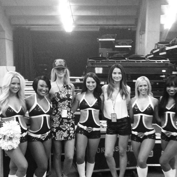 Lily Aldridge and Erin Heatherton posed with the Oklahoma Thunder dancers backstage at the Rock for Oklahoma benefit concert. Source: Instagram user lilyaldridge