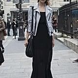 Jac Jagaciak wearing an Amber Sakai jacket and a Balenciaga bag.