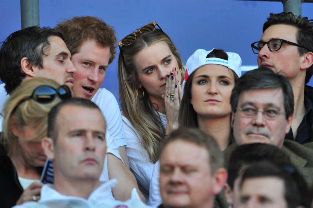 Nothing says royal romance like going to a rugby match. Following his PDA moment at the We Day UK charity event, Prince Harry took his girlfriend, Cressida Bonas, to the England vs. Wales rugby match in London on Sunday. The pair sat close to one another and had intimate chats, but they didn't show the same level of cuddling and kisses as they did at the concert on Friday. However, Cressida traded her usual hipster clothes for a simple and, perhaps, more rugby-match-appropriate look of a white blouse and gold jewellery. The couple have been dating for two years, but this weekend was the first time that we've seen them really take their love public. Despite the fact that the two have been dating for some time, Cressida has reportedly not yet met Queen Elizabeth II. However, that may soon change as there are rumours that Harry is planning on bringing Cressida with him to Balmoral in the northern Summer to meet with his grandmother. (She has reportedly already had several stays at the Queen's Winter estate, Sandringham, but not when the Queen was present.) A trip to Balmoral is the standard rite of passage for almost anyone who is involved in a serious relationship with a royal, so some are taking this as a sign that Harry may be preparing to pop the question. But Harry and Cressy fans shouldn't get their hopes up for a royal engagement just yet, as those types of rumours have been circling the couple pretty much ever since they laid eyes on each other in 2012.