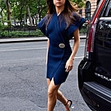Selena's Jacquemus wrap dress had a shorter hemline, but she added a sophisticated style note by mixing navy and black with a pair of Louis Vuitton heels. Selena's sleeves were wide, so when she turned to the side, you could catch a peek of some side boob (NBD).