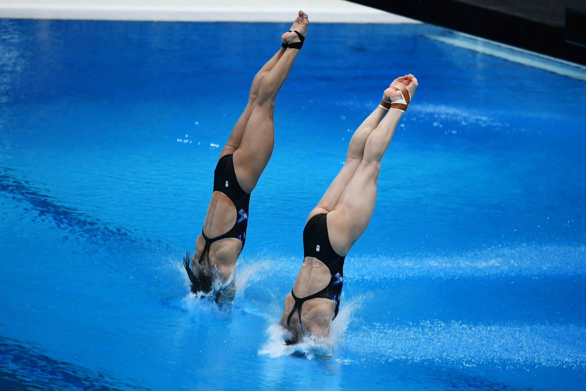 Pandelela Pamg and Mun Yee Leong of Malaysia compete in the women's synchronised 10m platform at the FINA Diving World Cup, which doubles as a test event for the 2020 Tokyo Olympics, at the Tokyo Aquatics Centre on May 2, 2021. (Photo by Charly TRIBALLEAU / AFP) (Photo by CHARLY TRIBALLEAU/AFP via Getty Images)