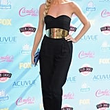 Erin Andrews looked fierce in a belted jumpsuit and jewelry by Robert Lee Morris.