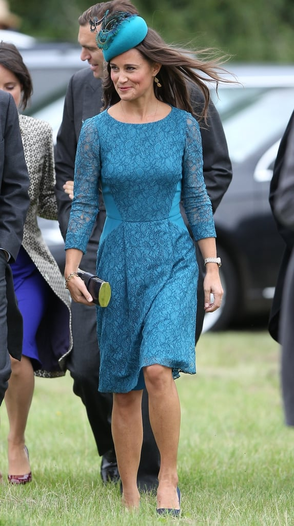 Pippa went monochromatic in a blue lace gown with matching feather-embellished fascinator when she accompanied Prince William and Prince Harry to the wedding of close friends Lady Laura Marsham and James Meade.