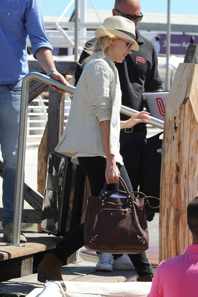 Naomi Watts carried a brown handbag getting onto a boat at the Venice Film Festival.