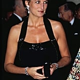The royal stunned during a charity dinner at the Palace of Versailles in France in November 1994.