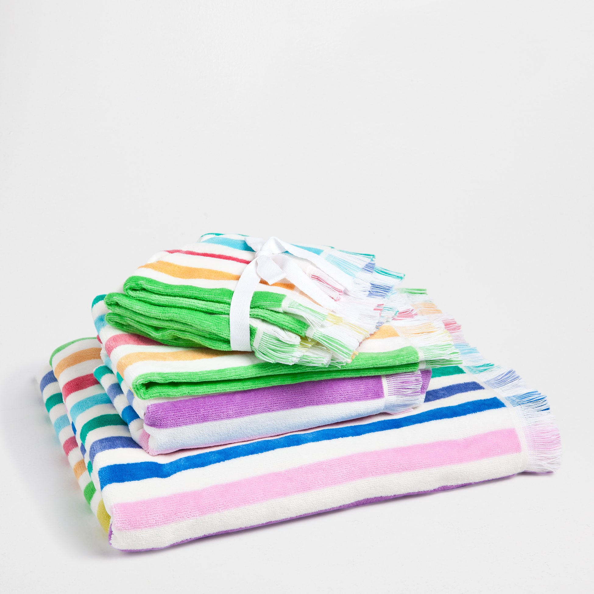 Your bathroom will go from drab to fab simply by folding one of these colorful velour towels ($15 for set of three) on your sink.