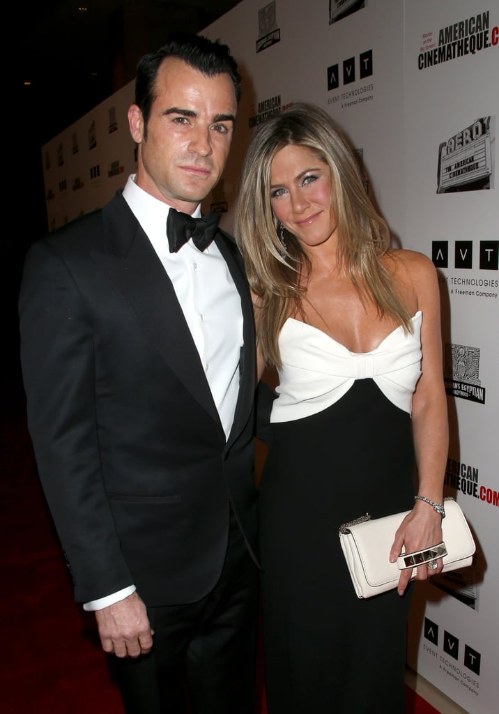 Jennifer Aniston and Justin Theroux smiled for photos in LA.