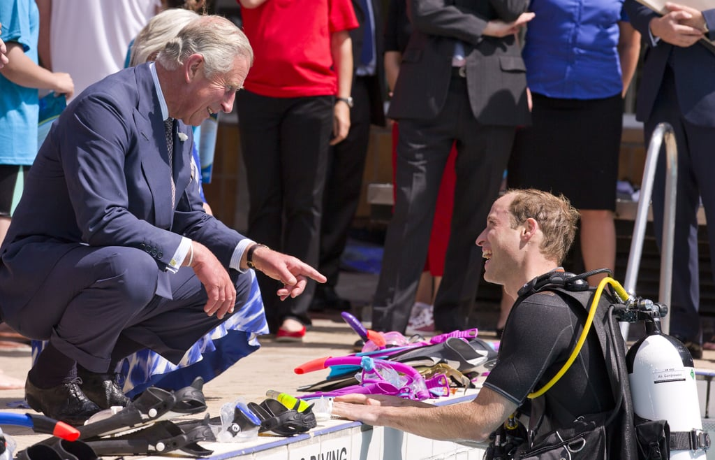 """Prince William put his royal physique on display on Wednesday when he donned a wetsuit and snorkel gear to splash around with the British Sub-Aqua Club. The Duke of Cambridge was joined at the event by his father, Prince Charles, who looked a little displeased when the chairman of the club said that Charles was """"quite buff"""" during his own diving days in the 1970s. After the Prince of Wales gave a quizzical look to his son, William joked, """"Pa, you should be pleased!"""" (To be fair, Charles was quite buff back in the day!) The Prince of Wales saw the lighter side of the comment when he took the stage, saying, """"I know my eldest will now demonstrate his buff credentials,"""" referring to William's skintight snorkel gear. Of course, the focus of the event wasn't just on water sports and buff royals, as William said during his own speech that he hopes that he can get his son, Prince George, into snorkeling when he gets older. """"I hope one day my son, George, might follow in our footsteps,"""" the duke said. """"At the moment, bath time is quite painful, but hopefully donning a snorkel and mask might calm him down."""" While George may be a difficult bather, a new report has surfaced that he just recently started to sleep soundly through the night because he had difficulty digesting food. However, he is now on solid food and is reportedly on good behavior. There will likely be more reports on George as the littlest royal prepares for his first birthday on 22 July. Later that day, William kept his clothes on when he joined Prince Harry to make royal history with the first-ever royal Google+ Hangout. The brothers also snapped a selfie together inside Buckingham Palace, making them the highest-ranking royals to ever do so."""